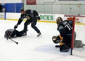 Boston Bruins goaltender Malcolm Subban (70) keeps an eye on defenseman Zdeno Chara (33) and center David Krejci (46) during a drill at NHL hockey training camp in Wilmington, Mass., Friday, Sept. 19, 2014. (AP Photo/Elise Amendola)