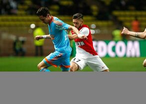 Marseille's French midfielder Florian Thauvin, left, challenges for the ball with Monaco's Belgium midfielder Yannick Ferreira Carrasco, during the League One soccer match between Monaco and Marseille, at Louis II stadium in Monaco, Sunday, Dec. 14, 2014. (AP Photo/Claude Paris)