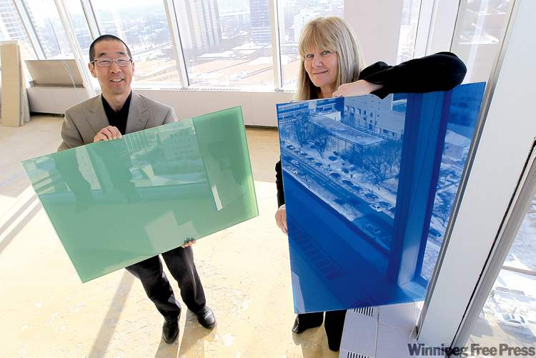 Ron Suzuki of Smith Carter Architects and Engineers Inc. and Karen Lund of Morguard Investments Ltd. hold samples of outside panels that will be installed at 363 Broadway.
