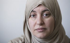 Wearing the Hijab when she went to court, Rania El-Alloul poses for a photograph at her home in Montreal, Saturday, February 28, 2015. A crowdfunding campaign in support of El-Alloul, who was refused her day in court because she was wearing a hijab, has raised more than $20,000 in its first day. THE CANADIAN PRESS/Graham Hughes