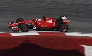 Ferrari driver Sebastian Vettel of Germany steers his car during the second practice session for the Malaysian Formula One Grand Prix at Sepang International Circuit in Sepang, Malaysia Friday, March 27, 2015.(AP Photo/Thomas Lam)