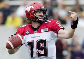 Calgary Stampeders quarterback Bo Levi Mitchell looks for a pass against the Hamilton Tiger-Cats during first half CFL football action in Hamilton, Ont., on Saturday, August 16, 2014. The Calgary Stampeders can celebrate a return off the bye week by securing top spot in the West Division. THE CANADIAN PRESS/Nathan Denette