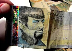 A likeness of Leonard Nimoy is drawn on a $5 bill in a handout photo. It turns out there's not a lot of logic in the belief that it's against the law to Vulcanize Wilfrid Laurier's likeness on the $5 bill.The death of Leonard Nimoy last week inspired people to post photos on social media of marked-up banknotes that show the former prime minister transformed to resemble Spock, Nimoy's famous