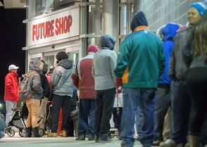 People wait outside for Future Shop before its 6 a.m. opening on Boxing Day in Ottawa on Friday, Dec. 26, 2014. THE CANADIAN PRESS/Justin Tang