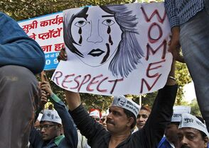 FILE - In this Dec. 8, 2014 file photo, supporters of Aam Aadmi (Common Man) Party (AAP) hold placards during a protest after a woman was allegedly raped by a driver from ride-booking service Uber in New Delhi, India. Uber promises to focus on rider safety amid increasing concerns that its drivers are not adequately screened for past criminal convictions. In a blog post Wednesday, Dec. 17, 2014, Uber's head of global safety defended the company's safety record but also wrote that