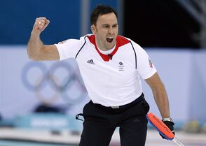 Britain's skip David Murdoch celebrates after delivering the last rock to defeat Sweden during the men's curling semifinal game at the 2014 Winter Olympics, Wednesday, Feb. 19, 2014, in Sochi, Russia. (AP Photo/Robert F. Bukaty)