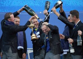 From left, Europe's players Jamie Donaldson, Henrik Stenson, Ian Poulter, Lee Westwood and Justin Rose pour champagne over captain Paul McGinley as they celebrate winning the 2014 Ryder Cup golf tournament, at Gleneagles, Scotland, Sunday, Sept. 28, 2014. (AP Photo/Scott Heppell)