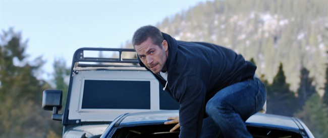FILE - This undated file photo provided by Universal Pictures shows, Paul Walker as Brian, in a scene from