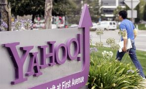FILE - A worker walks into Yahoo headquarters in Sunnyvale, Calif., in this July 29, 2009 file photo. Yahoo will supplant Google's search engine on Firefox's Web browser in the U.S., signaling Yahoo's resolve to regain some of the ground that it has lost in the most lucrative part of the Internet's ad market. The five-year alliance was announced Wednesday Nov. 19, 2014. (AP Photo/Paul Sakuima, File)