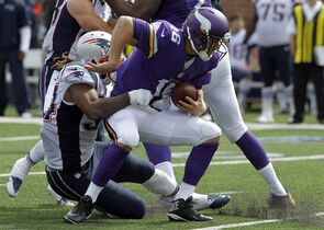 Minnesota Vikings quarterback Matt Cassel, right, is sacked for an 8-yard loss by New England Patriots linebacker Dont'a Hightower during the third quarter of an NFL football game Sunday, Sept. 14, 2014, in Minneapolis. (AP Photo/Ann Heisenfelt)