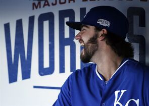 Kansas City Royals pitcher Brandon Finnegan sits in his team's dugout before Game 3 of baseball's World Series between the Kansas City Royals and the San Francisco Giants Friday, Oct. 24, 2014, in San Francisco. (AP Photo/Matt Slocum)