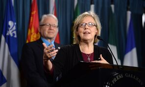Green Party Leader Elizabeth May, right, and Deputy Leader Bruce Hyer speak during a press conference on Parliament Hill in Ottawa on Monday, to call for 60 amendments to Bill C-51.