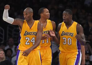 Los Angeles Lakers guard Kobe Bryant, left, gestures to count a basket as forward Wesley Johnson, center, and forward Julius Randle react as referees nullify it during the second half of a preseason NBA basketball game against the Utah Jazz, Sunday, Oct. 19, 2014, in Los Angeles. The Lakers on 98-91. (AP Photo/Mark J. Terrill)