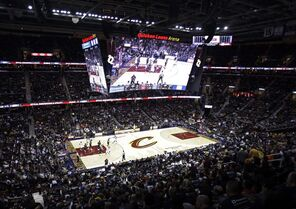 Under a new giant video scoreboard, the Cleveland Cavaliers play the New York Knicks in the third quarter of an NBA basketball game Thursday, Oct. 30, 2014, in Cleveland. (AP Photo/Tony Dejak)