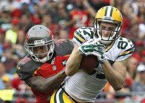 Green Bay Packers wide receiver Jordy Nelson (87) makes a catch in front of Tampa Bay Buccaneers strong safety Bradley McDougald (30) during the first quarter of an NFL football game Sunday, Dec. 21, 2014, in Tampa, Fla. (AP Photo/Brian Blanco)