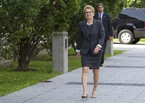 Ontario Premier Kathleen Wynne walks to meet Quebec Premier Philippe Couillard Thursday, August 21, 2014 at the premier's office in Quebec City. Prime Minister Stephen Harper is wrong in saying that police investigations, not a national inquiry, are the best way to deal with crimes involving missing and murdered aboriginal women, Ontario Premier Kathleen Wynne said Friday. THE CANADIAN PRESS/Clement Allard