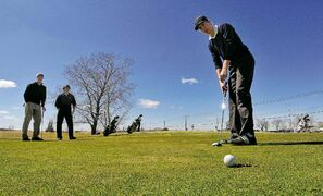 Determined golfers play their first game of the season at John Blumberg Golf Course on May 3, 2013.