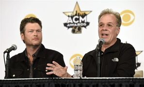 R.A. Clark, right, executive producer of Sunday's 50th Academy of Country Music Awards, takes part in a news conference on the event with co-host Blake Shelton at AT&T Stadium on Friday, April 17, 2015, in Arlington, Texas. (Photo by Chris Pizzello/Invision/AP)