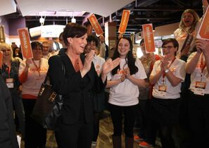 NDP candidate Theresa Oswald is greeted by supporters at Canad Inns Friday afternoon .