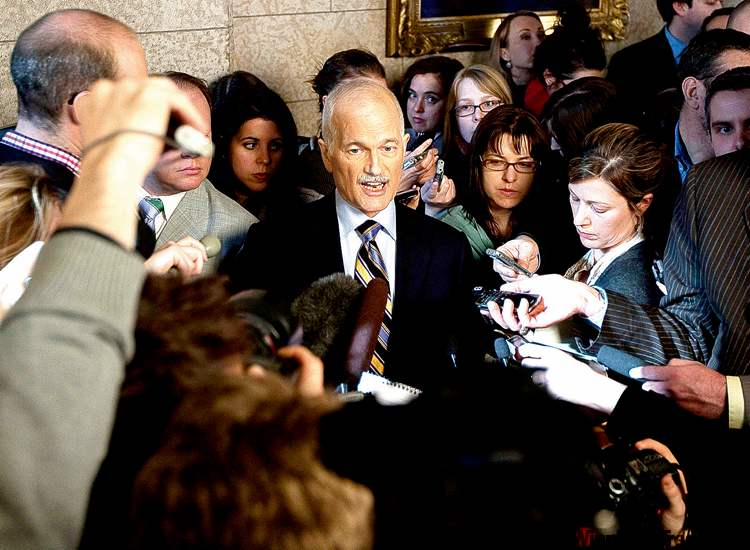 NDP Leader Jack Layton speaks with the media in the foyer of the House of Commons following the federal budget on Parliament Hill in Ottawa.