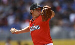 Miami Marlins starter Kevin Slowey pitches to the Seattle Mariners during the second inning of a baseball game in Miami, Sunday, April 20,2014. (AP Photo/J Pat Carter)