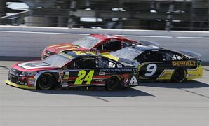 Jeff Gordon (24) drives past Marcos Ambrose (9) and Jamie McMurray (1) during the NASCAR Sprint Cup series auto race at Chicagoland Speedway in Joliet, Ill., Sunday, Sept. 14, 2014. (AP Photo/Nam Y. Huh)