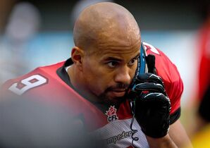 Calgary Stampeders' Jon Cornish speaks to coaches on a phone on the sideline during the first half of a pre-season CFL football game against the B.C. Lions in Vancouver, B.C., on June 20, 2014. CFL star running back Jon Cornish says he's ready to play Sunday in Ottawa. The league's most valuable player last season has been out of the Stampeders lineup with concussion symptoms since the season opener June 28. THE CANADIAN PRESS/Darryl Dyck