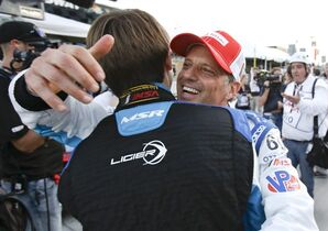 Oswaldo Negri Jr., right, of Brazil, celebrates with co-driver Matt McMurry on pit road after winning the pole position for the IMSA 24 hour auto race at Daytona International Speedway, Thursday, Jan. 22, 2015, in Daytona Beach, Fla. (AP Photo/John Raoux) 2 Honda
