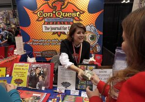 In this Oct. 9, 2014 photo, Shelley Harper, from Woodinville, Wash., works at her ConQuest Adventure Journal booth during the first day of New York Comic Con, at the Javits Convention Center. Harper raised nearly $12,000 to make her ConQuest Adventure Journals, a book for Comic Con attendees to store autographs, photos and other mementos, after it was chosen as a Kickstarter Staff Pick. (AP Photo/Richard Drew)