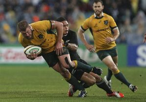 Australian Wallabies James Slipper left, is tackled by New Zealand All Black Aaron Smith during their Bledisloe Cup rugby test match in Sydney, Australia, Saturday, Aug. 16, 2014.The match was a draw at 12-12.(AP Photo/Rob Griffith)