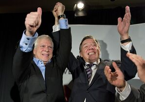 Coalition Avenir Quebec elected candidate Francois Paradis, left, celebrates his victory in a byelection with CAQ Leader Francois Legault in Levis, Que., on Monday, October 20, 2014. THE CANADIAN PRESS/Jacques Boissinot