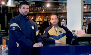 Jeffrey Bannon, director of marketing for the Winnipeg Blue Bombers, left, stands with Allan Hnatiuk, retail manager, in what Bannon calls one of the best retail sports stores in Canada, at the new Investors Group Field.