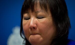 Carol Todd fights back tears as she listens during a Royal Canadian Mounted Police news conference in Surrey, British Columbia, on Thursday, April 17, 2014. A 35-year-old man alleged to be involved with the online extortion of Todd's 15-year-old daughter, who committed suicide in 2012, has been arrested in the Netherlands. (AP Photo/The Canadian Press, Darryl Dyck)