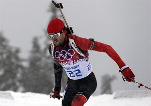Canada's Jean-Philippe le Guellec competes during the men's biathlon 15k mass-start, at the 2014 Winter Olympics, Tuesday, Feb. 18, 2014, in Krasnaya Polyana, Russia. (AP Photo/Felipe Dana)