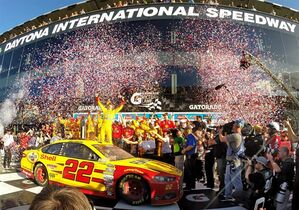 Joey Logano celebrates in Victory Lane after winning the Daytona 500 NASCAR Sprint Cup series auto race at Daytona International Speedway, Sunday, Feb. 22, 2015, in Daytona Beach, Fla. (AP Photo/Orlando Sentinel, Joe Burbank) MAGS OUT; NO SALES