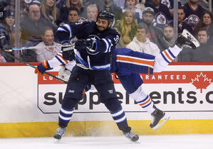 First in a short sequence of Dustin Byfuglien's smashing hit on Luke Gazdic during the second period at MTS Centre Monday night.