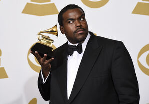Rodney Jerkins poses in the press room with the award for record of the year for Stay With Me.