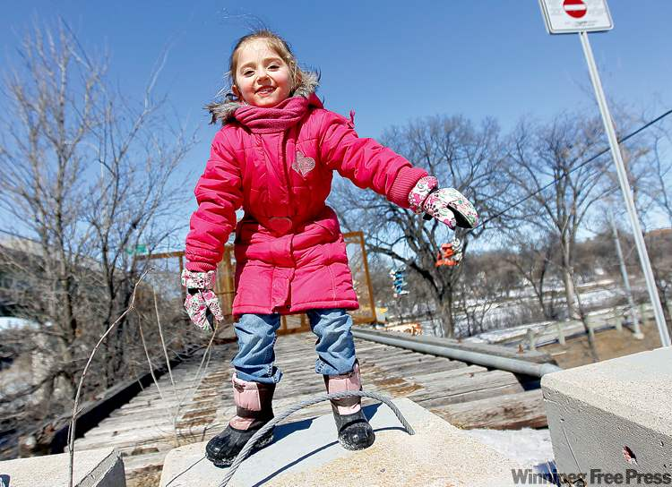 Ava Boudrie, 5, plays along Wellington Crescent.