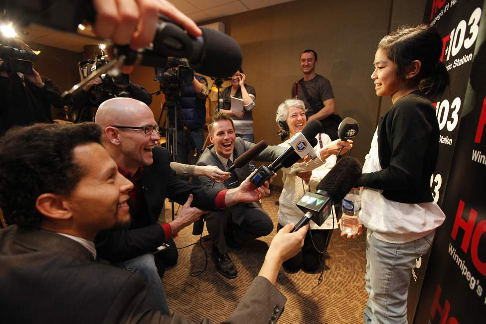 A giddy crew of media seem intoxicated with Maria Aragon at a press conference after she spoke with Lady Gaga on the radio at Hot 103 in Winnipeg. It must have been a slow news month. February 18, 2011