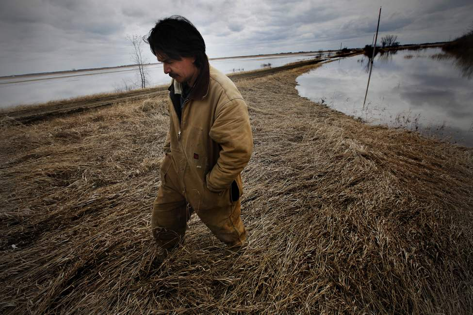 Gerald Tait, assistant EMO on Roseau River First Nation, stands on a community ring dike on the reserve. The community was evacuated under threat of flooding. April 19, 2011 (JOHN.WOODS@FREEPRESS.MB.CA)