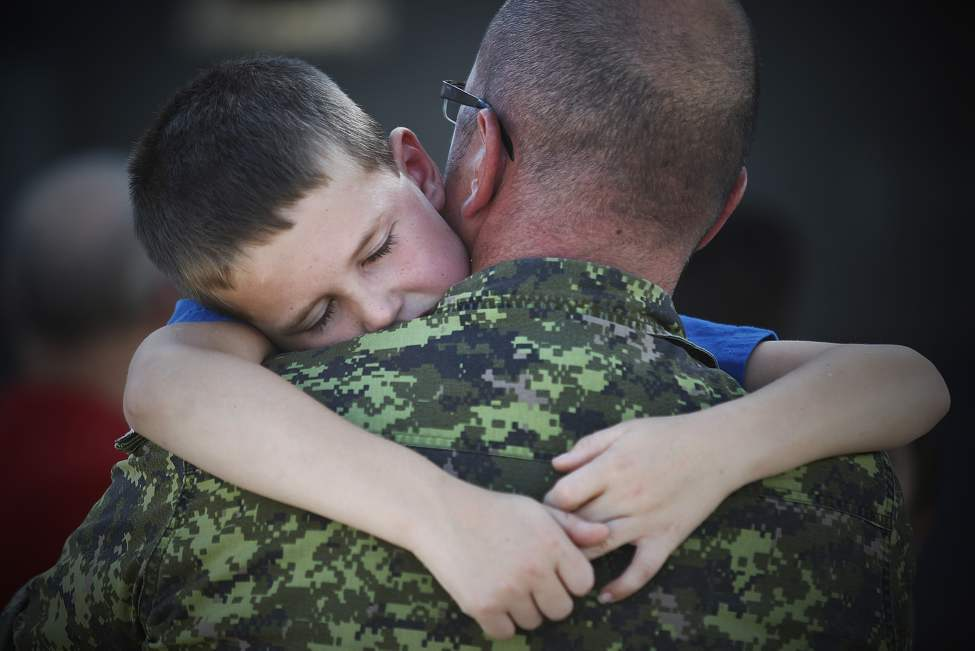 Seven year old Kayden can't let go of his dad Master Corporal Ryan Maher after he returned home at 17 Wing from the Libyan Operation Mobile which is based in Italy. September 9, 2011. (John Woods/Winnipeg Free Press)