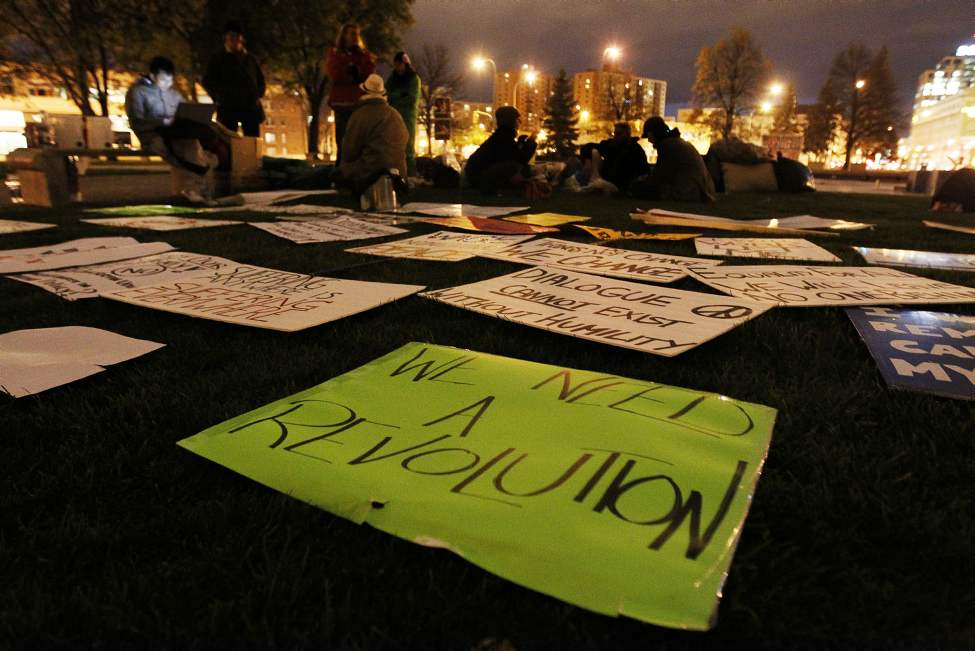 People discuss world issues and injustices and erect tents as part of Occupy Winnipeg in Memorial Park Winnipeg. October 15, 2011