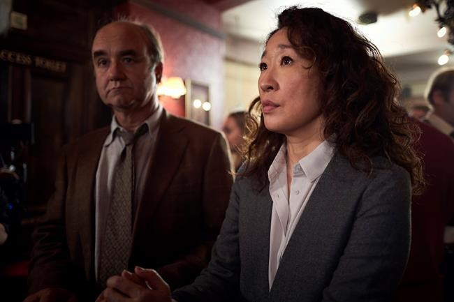 "This image released by BBC America shows Sandra Oh in a scene from ""Killing Eve."" Oh was nominated Thursday for an Emmy for outstanding lead actress in a drama series. The 70th Emmy Awards will be held on Monday, Sept. 17. (BBC America via AP)"