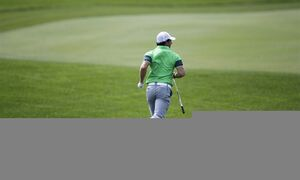 Rory Mcllroy runs down the first fairway after teeing off for the second time during the first round of the Honda Classic golf tournament, Thursday, Feb. 26, 2015 in Palm Beach Gardens, Fla. McIlroy scored a 6 on the par 4 hole. (AP Photo/Luis M. Alvarez)