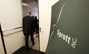 A man enters the Sprott Inc. Annual General Meeting in Toronto on May 23, 2012. THE CANADIAN PRESS/Aaron Vincent Elkaim