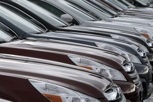 In this Tuesday, Feb. 26, 2013, photo, Subaru Legacys are lined up at Twin City Subaru in Berlin, Vt. Strong auto sales, better hiring and a continued housing recovery helped the U.S. economy grow in January and February throughout the country, according to a survey released Wednesday, March 6, 2013. by the Federal Reserve. (AP Photo/Toby Talbot)