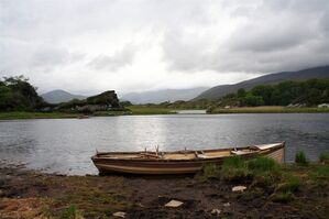 This May 28, 2012 photo shows a boat tied up on the shore of Muckross Lake in Killarney National Park, County Kerry, Ireland. Ireland is about 300 miles from north to south and a driving trip in the country's western region takes you along hilly, narrow roads with spectacular views ranging from seaside cliffs to verdant farmland. (AP Photo/Jake Coyle)