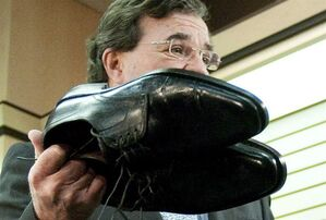 Finance Minister Jim Flaherty shows off his newly re-soled shoes during a pre-budget photo opportunity at Healthy Feet Shoe Repair in Ottawa on Monday, March 22, 2011. The standard pre-budget photo-op features the federal finance minister buying a new pair of shoes.Now, Flaherty's preparing to tell Canadians how it feels to walk a mile in those shoes. THE CANADIAN PRESS/Sean Kilpatrick