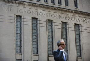A man walks past a building in Toronto that used to house the Toronto Stock Exchange on August 18 2011. THE CANADIAN PRESS/Aaron Vincent Elkaim