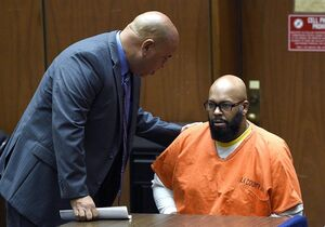 FILE - In this March 9, 2015 file photo, attorney Mathew Fletcher, left, talks with his client Marion